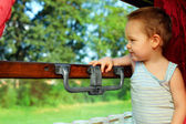 Cute baby boy having exciting journey by train — Stock Photo