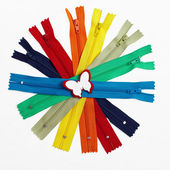 Colorful group of zippers gathered in circle. isolated on white — Stock Photo