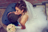 Beautiful bride and groom kissing. top view — Stock Photo