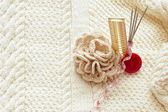 Set for home knitting with crochet flower on pattern background — Stock Photo