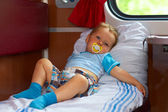 Little baby boy passenger traveling by train in sleeper car — Stock Photo