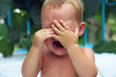 Close-up of upset little baby boy crying outdoors — Stock Photo