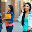 Casual woman talking on the mobile phone, while walking the street — Stock Photo #13672363