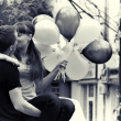 Stock Photo: Love couple kiss, with balloons outdoor