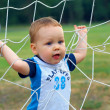 Little baby boy winner playing sport game — Stock Photo