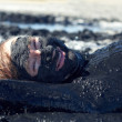 Outdoor portrait of man lying in healing clay — Foto de Stock