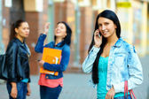 Casual woman talking on the mobile phone on the street — Stock Photo