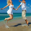 Young happy couple having fun on sea beach. Black sea, Crimea — Stock Photo