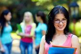 Portrait of female student in glasses outdoors — Stock Photo