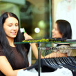 Beautiful elegant woman shopping in clothes store — Stock Photo #14319949