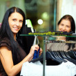Beautiful elegant woman shopping in clothes store — Stock Photo