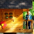 Cute baby boy playing in tree house, sunny outdoor — Stock fotografie