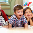 Group of happy kids watching tv at home — Stok fotoğraf