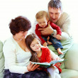 Grandparents reading books to beautiful grandchildren — Stock Photo