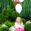 Beautiful little princess girl  with balloons on green lawn — Stock Photo
