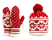 Winter cap and mittens hand knitted with jacquard motifs, isolated — Stock Photo
