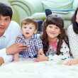 Happy family of four persons at home — Stock Photo