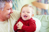Happy grandfather with laughing grandson, indoors — Stock Photo