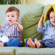 Two cute baby boys playing with toys at home — Stockfoto