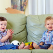 Two cute baby boys playing with toys at home — Stock Photo #15637341