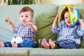 Two cute baby boys playing with toys at home — Stock Photo