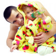 Stock Photo: Smiling father gently hugging little daughter in bathrobe