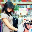 Royalty-Free Stock Photo: Young elegant woman shopping in clothes store