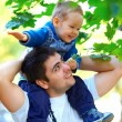 Stock Photo: Father and son having fun playing outdoors