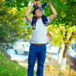 Father and son having fun playing outdoors — Stock Photo