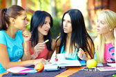 Four female student studying for the exam, outdoors — Stock Photo