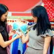 Beautiful women buying bra in lingerie shop — Stock Photo