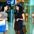 Smiling female friends shopping in the city mall — Stock Photo #16633545