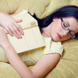 Young woman fell asleep after reading book — Stock Photo