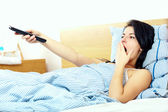Woman watching tv in the morning — Stock Photo