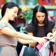 Elegant women shopping in retail clothing store — Foto Stock