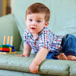 Stock Photo: Curious little baby toddler playing toys