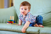 Curious little baby toddler playing toys — Stock Photo
