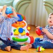 Cute funny baby boys playing with toys at home — Stock Photo #18119117