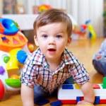 Curious baby boy studying nursery room — Stock Photo