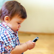Curious baby toddler exploring mobile phone — Stock Photo #18123233