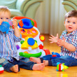 Funny baby toddlers playing toys at home — Stock Photo #18186207