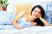 Happy woman starting a new sunny day in good mood — Stock Photo