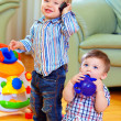 Stock Photo: Funny baby toddlers playing at home