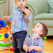 Stock Photo: Funny baby toddlers playing toys at home