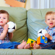 Cute little baby boys playing toys at home — Stockfoto