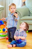 Funny baby toddlers playing toys at home — Stock Photo