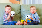 Cute little baby boys playing toys at home — Stock Photo