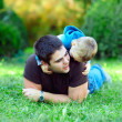 Father and son havin fun on green field — Stock Photo