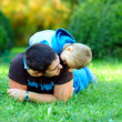 Father and son having fun in green park — Stock Photo #18621787
