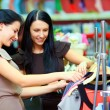 Two smiling woman shopping in retail store — Stock Photo #18676305